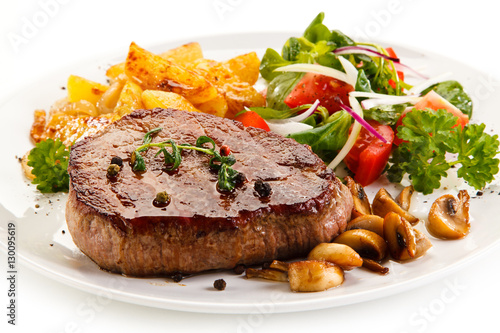 Deurstickers Klaar gerecht Grilled steak, baked potatoes and vegetable salad on white background