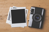 Blank vintage instant photograph with a retro camera - 130110871