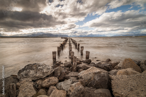 boat pier with old logs and stilts for landscape travel background Poster