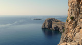 The coast of Tilos island with blue sea and big stack, Greece - 130137221
