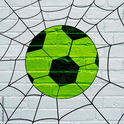 Art urbain, ballon de foot allant dans une toile d'araignée © brimeux
