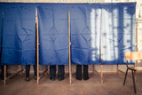 People vote in voting booth
