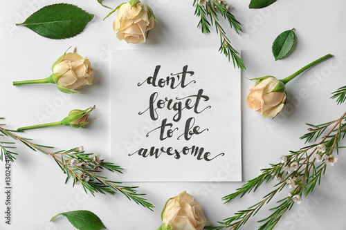 "Poster Quote ""Dont forget to be awesome"" written on paper with roses and leaves on white background"