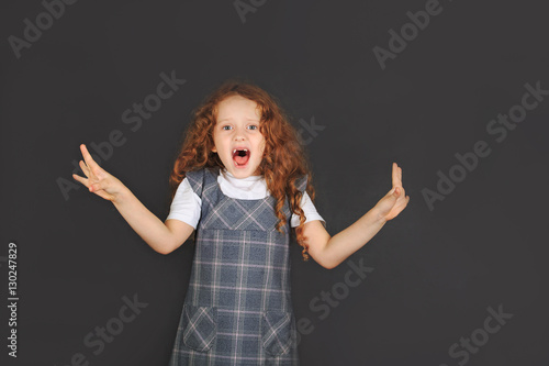 School girl showing dislike emotion facial expression and  hand