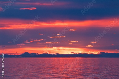 Tuinposter Crimson the sunset at Lake Baikal in summer