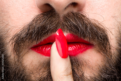 Bearded Man with Red Lipstick on His Lips and Nail Polish Making Silence Gesture Poster