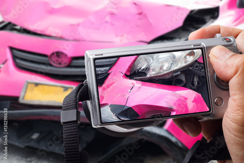 Close up of hand man holding digital camera and take photo of car accident Poster
