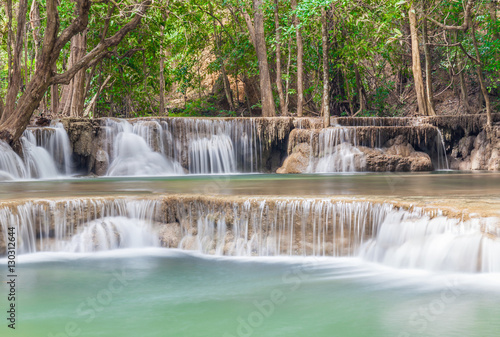 Fotobehang Olijf Beautiful waterfall cascades in Erawan National Park in Thailand