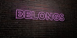 BELONGS -Realistic Neon Sign on Brick Wall background - 3D rendered royalty free stock image. Can be used for online banner ads and direct mailers..