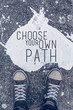Choose your own path motivational quote on urban asphalt backgro