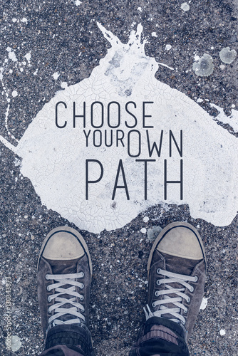 Choose your own path motivational quote on urban asphalt backgro Photo by Bits and Splits