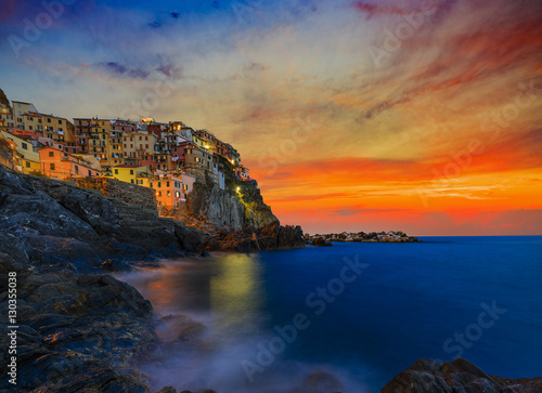 Poster Cinque Terre colorful traditional houses on a rock over Mediterranean sea after sunset at the dusk, Manarola, , Italy, Ligurian Coast