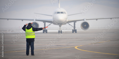 airport worker signaling
