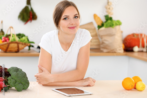young woman is making online shopping by tablet computer and credit