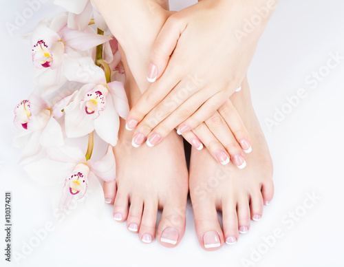 Leinwanddruck Bild female feet at spa salon on pedicure and manicure procedure