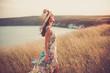 Modern girl in light summer dress
