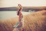 Modern girl in light summer dress - 130392860