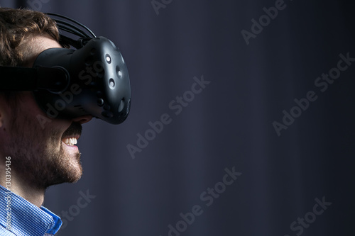 Attractive man wearing virtual reality goggles. VR headset