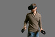 bearded man using the virtual reality headset and two controller
