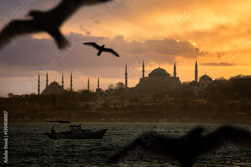 Poster Iconic Istanbul Old Town silhouette and the fishing boat during sunset