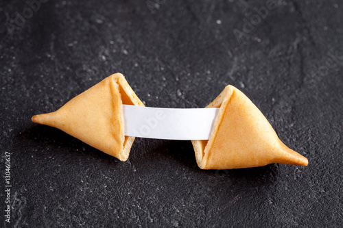 Chinese fortune cookie with prediction on dark background top view Poster