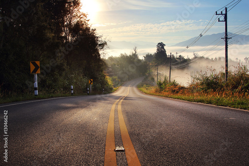 Beautiful scenery of route and journey during sunrise with the mist and beautiful nature at Ban Huay Kon ,Chaloem Phra Kiat district ,Nan province in Thailand .Travel and natural Concept