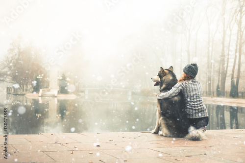 Poster Image of young girl with her dog, alaskan malamute, outdoor