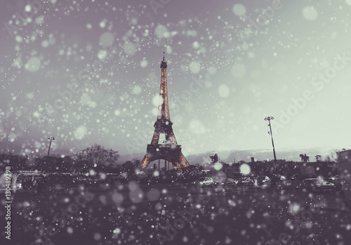 Fotobehang Eiffeltoren Paris cityscape with Eiffel tower at winter night in France. Vintage colored soft focus picture. X-mas, Business, Love and travel concept