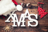 Xmas greeting message on wooden background