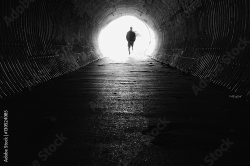 Poster Tunesië light at the end of the tunnel with silhouette of man