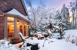 Wintry home at sunset - patio and garden blanketed in snow as sun goes down on a winter evening - 130572237