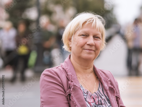 Poster Portrait of beautiful aged woman in the street