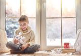 Fototapety Child makes paper snowflakes