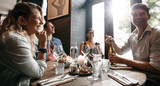 Group of friends enjoying an evening meal at a restaurant