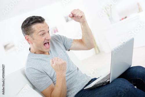 very happy man with laptop плакат