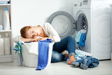 tired unhappy woman housewife is engaged in the laundry,