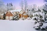 Last light fades as night falls on a snowy suburban home and garden - 130685617
