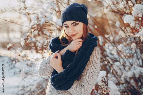girl walking in a winter city © hetmanstock2