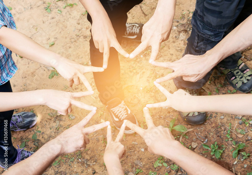 Posting finger of group of people in v shape, victory or star to