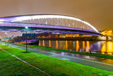 View of Lovers bridge from riverside park at night - 130706433