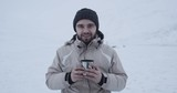 A young  traveler drinking a cup of tea and looking with smile. Winter Yamal 2016. Shot on Red Epic 4k