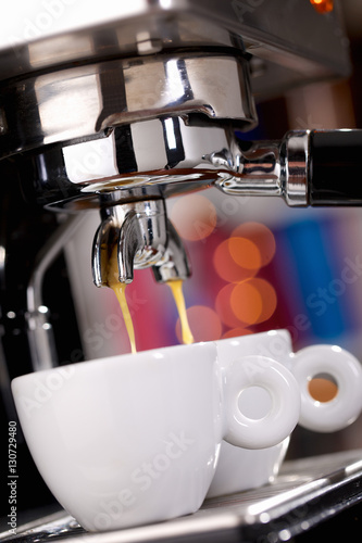Poster Close up of espresso machine filling two cups