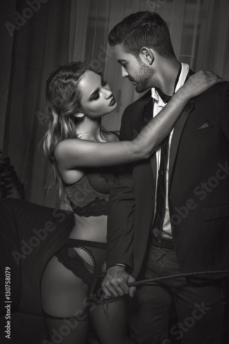 Poster Rich man foreplay with lover holding whip black and white