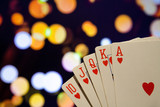 Royal flush poker cards combination on blurred background casino luck fortune