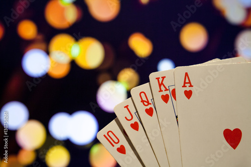 Royal flush poker cards combination on blurred background casino luck fortune плакат