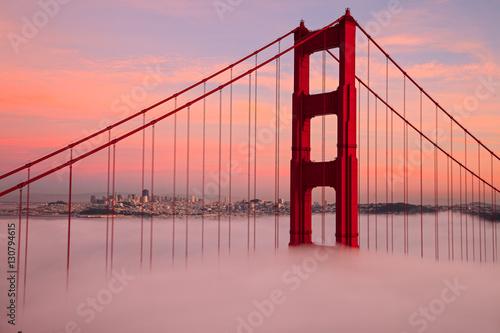 Fototapeta First Tower of the Golden Gate Bridge in Fog