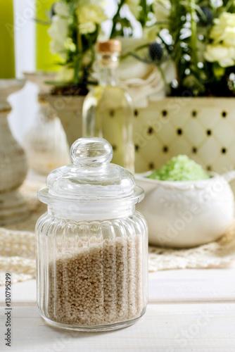 Jar of sea salt and bottle of liquid soap © agneskantaruk