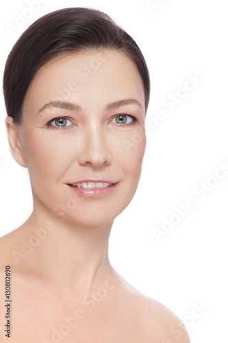 Poster Portrait of beautiful healthy happy smiling mature woman over white background