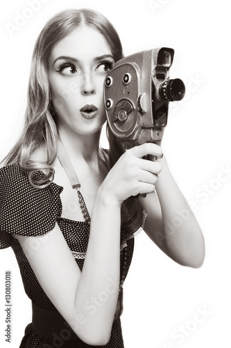 Poster Duotone shot of young beautiful curious girl with vintage camera over white back