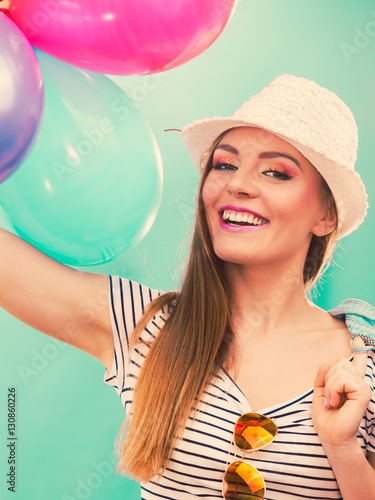 Woman summer joyful girl with colorful balloons Plakat